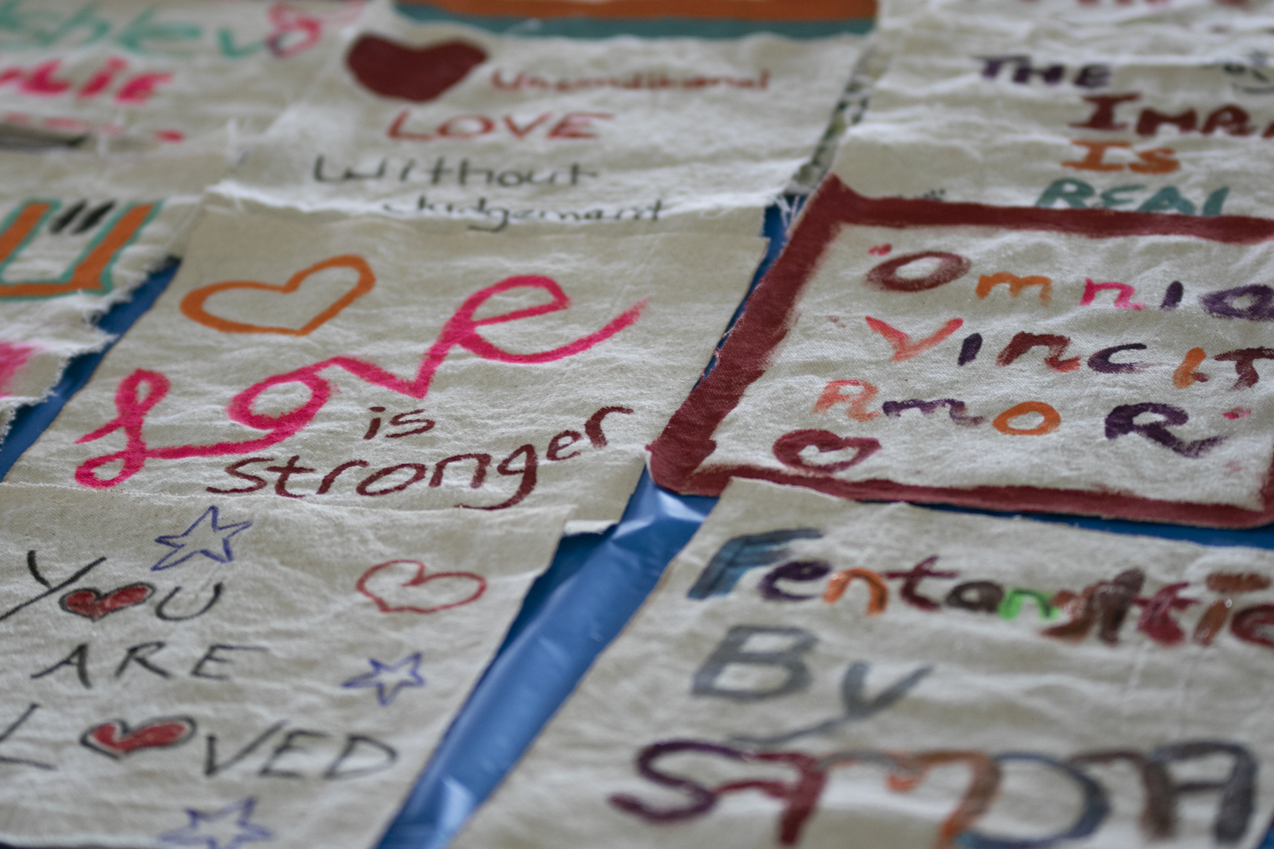 A quilt made of individuals squares with encouraging messages to people who use drugs
