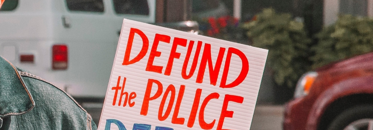 """A sign reading """"defund the police"""""""