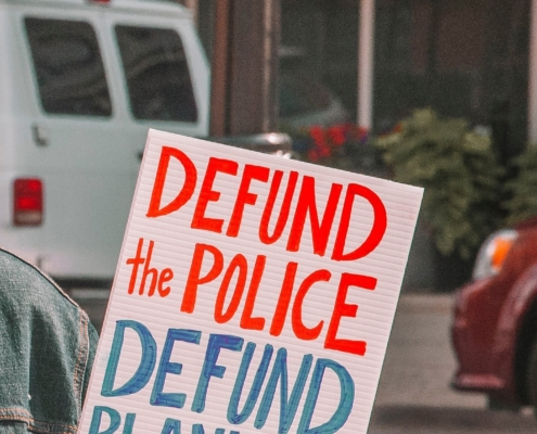 "A sign reading ""defund the police"""