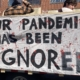 """Sign that reads """"our pandemic is being ignored"""""""